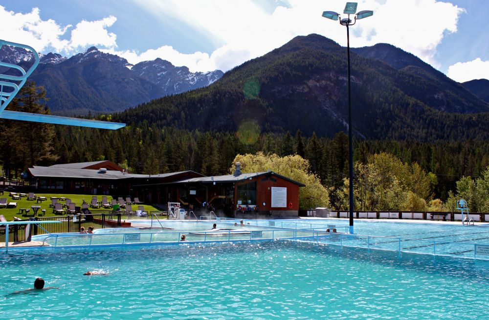 Get your adrenaline rush by ziplining and then relax by soaking in natural mineral hot springs.